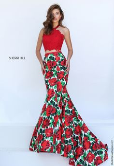 Have all eyes on you in this flattering two piece prom dress 50493 from Sherri Hill as it showcases a halter lace top and mermaid skirt. The crop top features gorgeous lace appliques with subtle bead