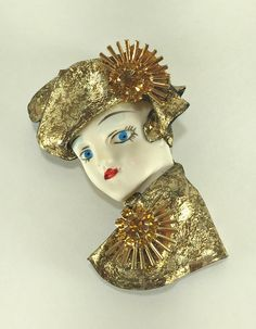 A personal favorite from my Etsy shop https://www.etsy.com/listing/479297461/lady-brooch-with-rhinestones-50s-style