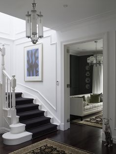 Dark floorboards and carpet stairs
