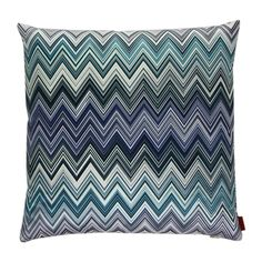 This Missoni Home Jarris cushion features the iconic Missoni thin zigzag stripe pattern in shades of blue, (may vary slightly from image due to cut of fabric). Luxuriously comfortable, this cushion...
