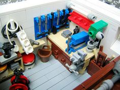 DaddiLifeForce - The Power of Lego - DaddiLife This is sooo going to replicate my new garage workshop when i move into my new place! Lego Display, Lego Modular, Lego Design, Robot Lego, Pokemon Lego, Lego Hacks, Lego Machines, Lego Furniture, Amazing Lego Creations