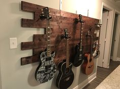Luisa's Guitar Display - Pinterest idea, wood, wood glue, tons of 3/4 screws, metal brackets... I found everything in Home Depot. The guitar hooks found in amazon..