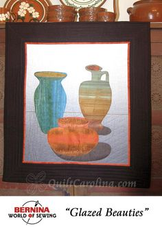 """""""Glazed Beauties"""" – this beautiful wall hanging quilt uses appliqué to showcase North Carolina's renown for pottery! A 2017 Quilt! Carolina pattern."""