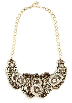 A Sparkling Statement Necklace. Your friends know your dialogue as simply dazzling - much like the beaded statement necklace youre sporting! #gold #prom #modcloth