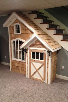 Under the stairs playhouse!  Even has a loft inside!  What a great way to utilize this space.  The address is our daughter's birthday!   My husband is a genius!!