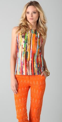 Love the blouse and the orange slacks!