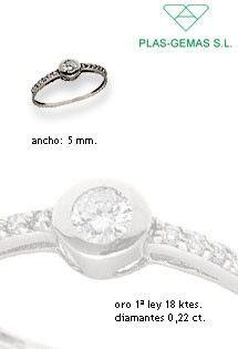 Solitario de oro blanco de 1ª Ley de Plas-Gemas S.L. con diamantes de 0,22 kilates engastados en talla brillante por el centro y brazos del anillo