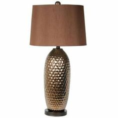 """Illuminate your writing desk or favorite reading nook with this ceramic table lamp, showcasing a honeycomb-style base and chocolate-hued shade. Product: Table lampConstruction Material: CeramicColor: Chocolate Accommodates: (1) Bulb - not included Dimensions: 30"""" H x 7"""" Diameter Cleaning and Care: Dry wipe clean"""
