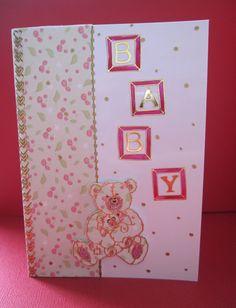 Baby announcement card with a teddy bear