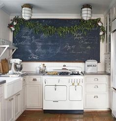 Making a New House Look Old — Cottage Living Love the huge blackboard but could never reach it to write on it New Kitchen, Vintage Kitchen, Kitchen Dining, Kitchen Decor, Kitchen Board, Happy Kitchen, Country Kitchen, 1940s Kitchen, Kitchen Stove