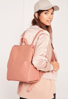 A square backpack that'll give you a ~rosy~ outlook on work or school.