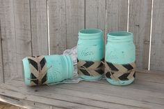 3 quart size mason jars hand painted a soft mint green, lightly distressed and wrapped with black chevron burlap, a twist of natural jute and a protective coating. They are not painted on the inside a
