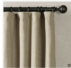Detail of Restoration Hardware rod pocket curtains hung with drapery hooks