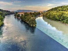 CONFLUENCE OF RHONE AND ARVE RIVERS, SWITZERLAND In Geneva, travelers can witness the majestic sight of two rivers colliding with one another. The Rhone River starts in Lake Lehman, while the Arve River is fed by glaciers in the Chamonix valley. When the two bleed into one another, it makes for a stunning sight.