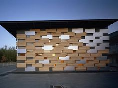 Keeping it big in Japan, the mixed material façade of the Hoshinosato Annex as built by Kengo Kuma and Associates is comprised of aluminum panels and wooden panels disposed in a gradational changing pattern.