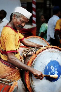 At Pune, In Color, The Dhol Player on Ganesha Immersion Day 2012 . What about getting lost in the festivals of India . Plan your visit on www.bestofjourney.us