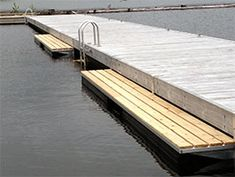Kayak Storage Enviro Float Manufacturing Ltd. Lake Dock, Boat Dock, Lake Floats, White Water Kayak, Floating Dock, Kayak Storage, Boat Lift, Lake Cabins, Outside Living
