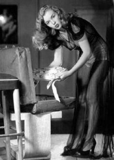 Marilyn💋  in a Pin Up Session  Removing baked goods from a suitcase by Earl Moran