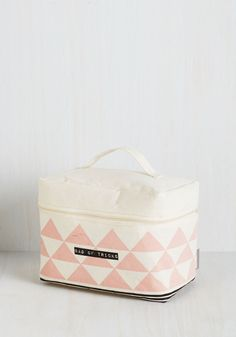 The decision to give your beauty hacks a home inside of this woven cosmetic case from Disaster Designs in a simple one! Your powders and pencils can't wait to take up residence within the waxed interior of this black and petal pink, triangle-printed cosmetics holder, and you're just as elated to use it.