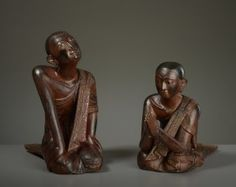 TWO MONKS KNEELING IN WORSHIP Catalog Number: AK0417-171 Lacquer, noble wood, inlay Burma late Konbaung to 1st half of the 20th cent. HEIGHT 45,6 CM and 35,8 CM