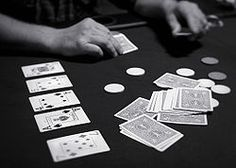 """Texas Hold 'em (also known as hold 'em or holdem) is a variation of the standard card game of poker. The game consists of two cards being dealt face down to each player and then five community cards being placed face-up by the dealer—a series of three (""""the flop"""") then two additional single cards (""""the turn"""" and """"the river"""" or """"fourth and fifth street"""" respectively), with players having the option to check, bet, raise or fold after each deal; i.e., betting may occur prior to the flop, """"on…"""