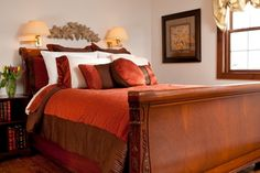 Bed | The Orlando Room at the  Stonecroft Country Inn located in Ledyard, CT.