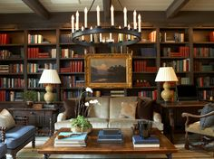 Warm, cozy library with velvet sofa, gourd lamps, oil painting - Tammy Connor Interior Design