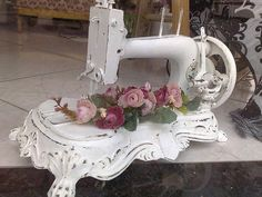 Old white sewing maching