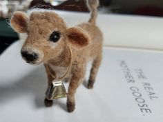 small jersey calf. made-to-order needle felted cow figurine. http://www.therabbittrail.com/shop/small-jersey-calf-made-to-order-needle-felted-cow-figurine Rosanna Dell