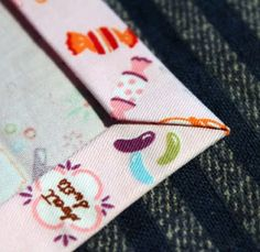 Excellent mitered corners method. (Great to use on homemade napkins, among other things.)