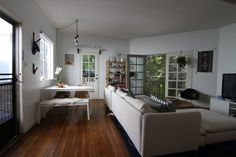 Lynn's Treehouse vote for me on apartment therapy :) #eames #sectional