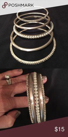 Bangle Bracelet Set Excellent condition!  Never worn. 2 Rhinestone, 1 'Pearl' and 2 Matte Silver Bangle Bracelets. Jewelry Bracelets