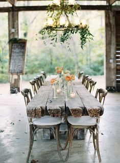 Nothing but bud vases sprinkled down the table; love it or hate it? We're kind of loving.