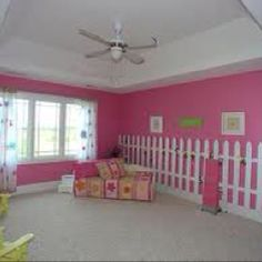 Pink garden girls bedroom. Emily wants a garden bedroom with purple and green colors. She wants a picket fence  on one wall and a large tree on another. And to fill in with butterflies and flowers.