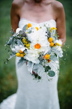 "One of Hilary's good friends created all the stunning florals for the wedding day. She carried mint dusty miller, white peonies, yellow billy balls, yellow ranunculus and silver brunia balls for a textured look we love. ""They were more incredible than all the Pinterest flowers I could have dreamed of,"" she says."