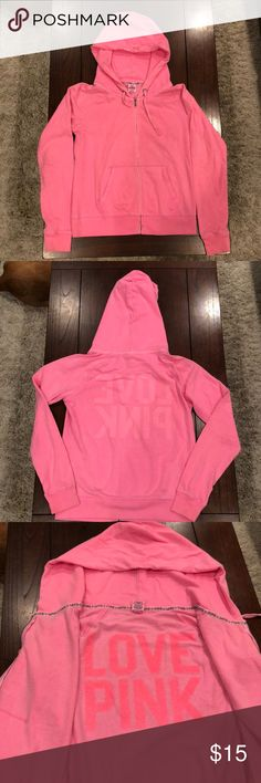 Victoria's Secret PINK Zipup Sweatshirt This bright pink sweatshirt is a comfy and fun piece to have in your closet. It's loose and has a large hood but is slightly worn. It is from Victoria's Secret PINK collection and is a size medium. PINK Victoria's Secret Tops Sweatshirts & Hoodies