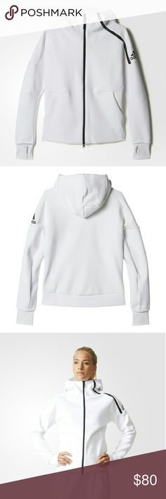 Adidas ZNE Womens Hoodie This hoodie is thick and warm!!! It has a 2-way zip, and  a hood design based on athlete insights reducing outside noise and accommodating over-the-ear headphones. The hood construction also features a slightly extended hood to help block disruptions. Hands stay covered with engineered thumbholes on the cuffs that can roll to the inside for a standard, clean look. The tapered fit accommodates an athletic silhouette with more room at the shoulders and a narrower…