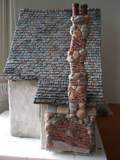 Detail of back side of fireplace and fantasy chimney - paperclay stone and brick.