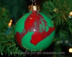 Learn how to drip paint inside ornaments to create beautiful effects! From Crafts For All Seasons