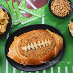 Football Bread Bowl filled with Taco Dip | HungryHappenings.com