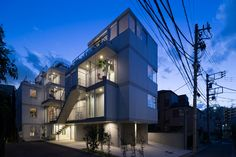 Apartment in Nishiazabu by SALHAUS: ten microapartment  units, each with balconies and stairways open to the street.