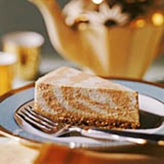 Save this one for the holidays! This recipe for Marbled Pumpkin Cheesecake is low calorie without losing any fabulous pumpkin flavor. @EatingWell