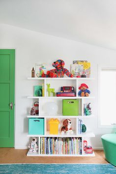 We also added a colorful rug, bright storage bins, and plenty of colorful accessories to give the room a look that's playful while still being as sophisticated (almost) as Jack.