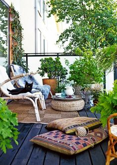 Outdoor Sanctuary: Play with textures in your outdoor space by mixing in woven rugs, bamboo chairs and colorful pillows. (via Elle Decoration)