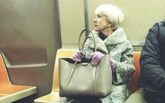 Man, I flippin LOVE Helen Mirren. Look at her, riding the subway in her purple gloves like she is not the DAME. Helen Mirren, Hugh Glass, New York Subway, Nyc Subway, Subway Art, Purple Gloves, Dame Helen, Woman In Gold, Perfect Posture