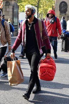 Odell Beckham Jr. wearing Amiri Velvet Bomber Jacket Merlot, Amiri Stack Jeans, Amiri Stack Boots