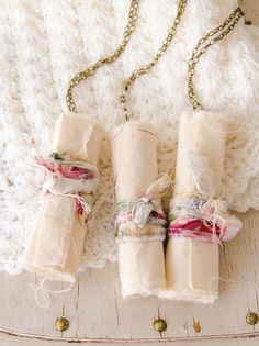 These spools of positivity by Lynne Moncrieff each have a positive word on them for one of her friends, and are packaged in wrapped muslin and torn fabric. | Somerset Life