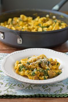 This lightened up Pumpkin Alfredo Tortellini Skillet with spicy sausage is a creamy, decadent, easy one-pot meal that's perfect for Fall. Just 332 calories or 9 Weight Watchers points! www.emilybites.com