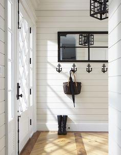 black & white contrast, anchor hooks, plank walls, beautiful door.  |   Muskoka Living Interiors