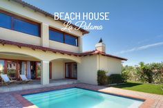 BEACH HOUSE LA PALOMA, Boubergstrand Self Catering Accommodation Cape Town - Spacious 2-bedroom holiday home across the road from the ocean. Spacious garden with poo and BBQ facilities, fully equipped kitchen includes dishwasher and washing machine. Lounge with fireplace, free wifi, garage. Sleeps 4.